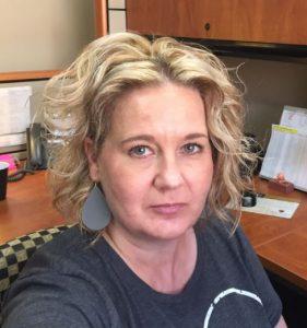 Andrea Cox at desk