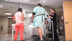 Test patient on treadmill with student and staff